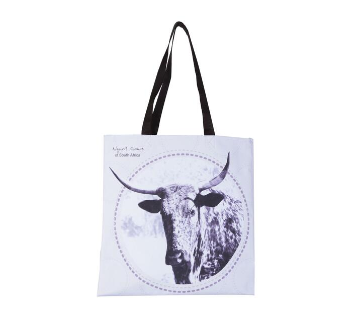 Tote Bag made with canvas with a nguni cow head print on a cream white background.
